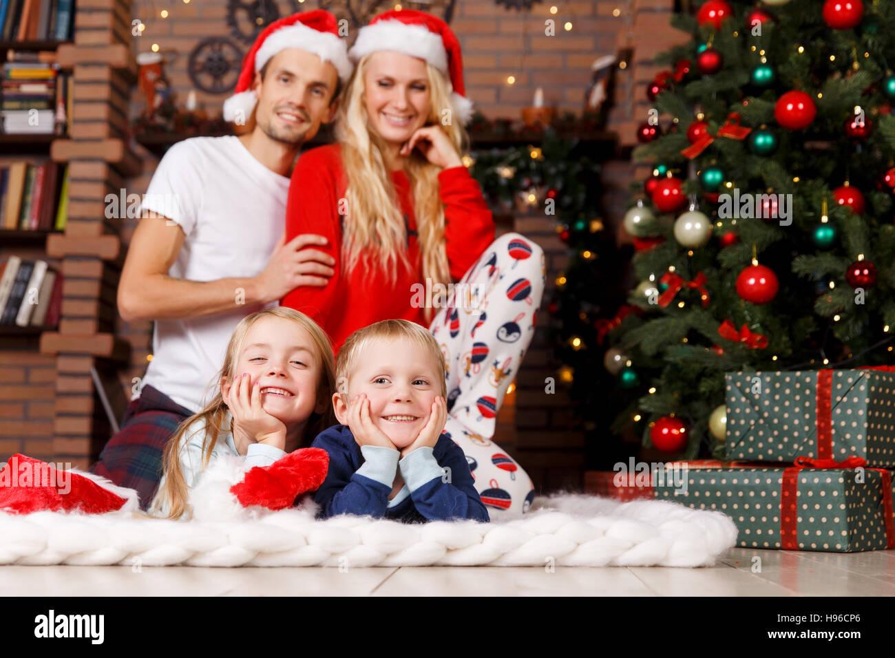 Family in sleepwear on Christmas - Stock Image