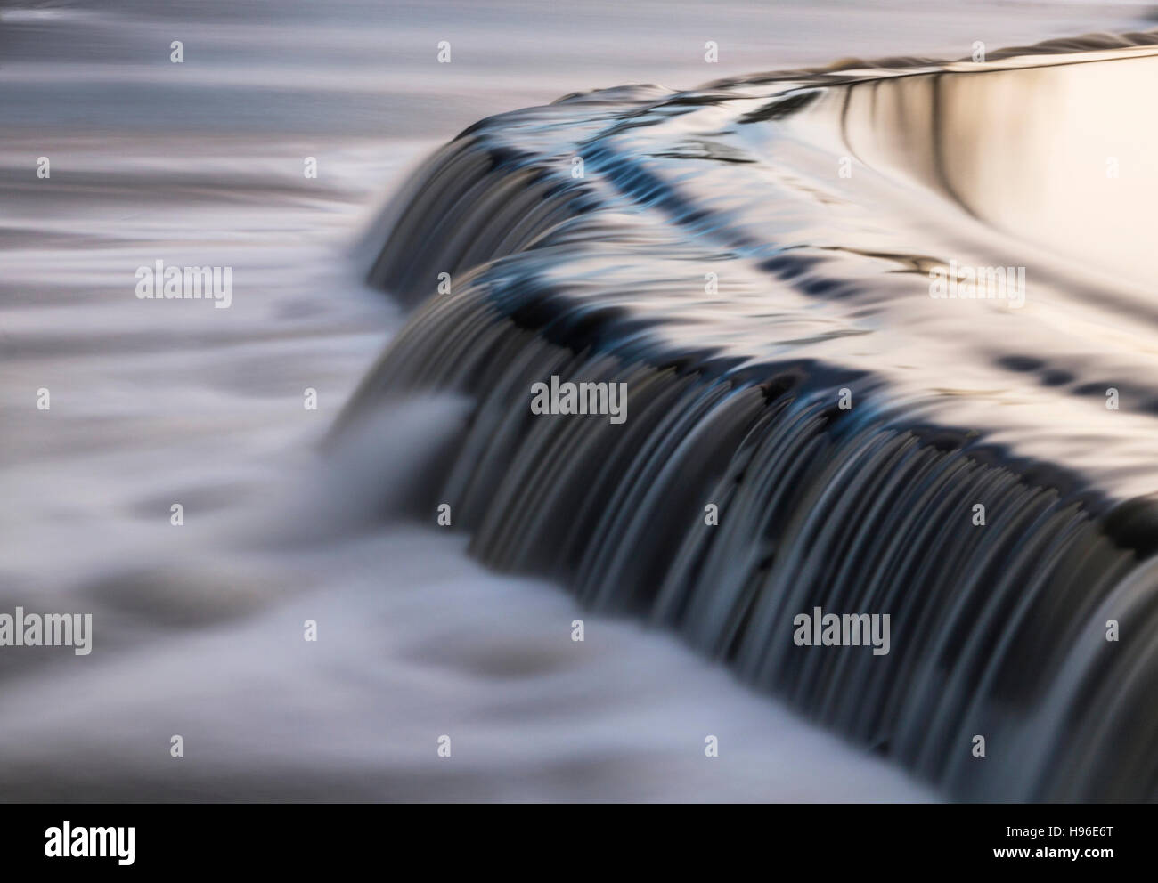 Water flowing over Warleigh Weir near Bath, UK - Stock Image