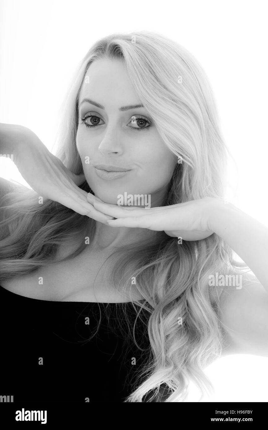 Portrait of a Girl Looking Cute and Happy Resting Her Chin on Her Hands Against a White Background - Stock Image