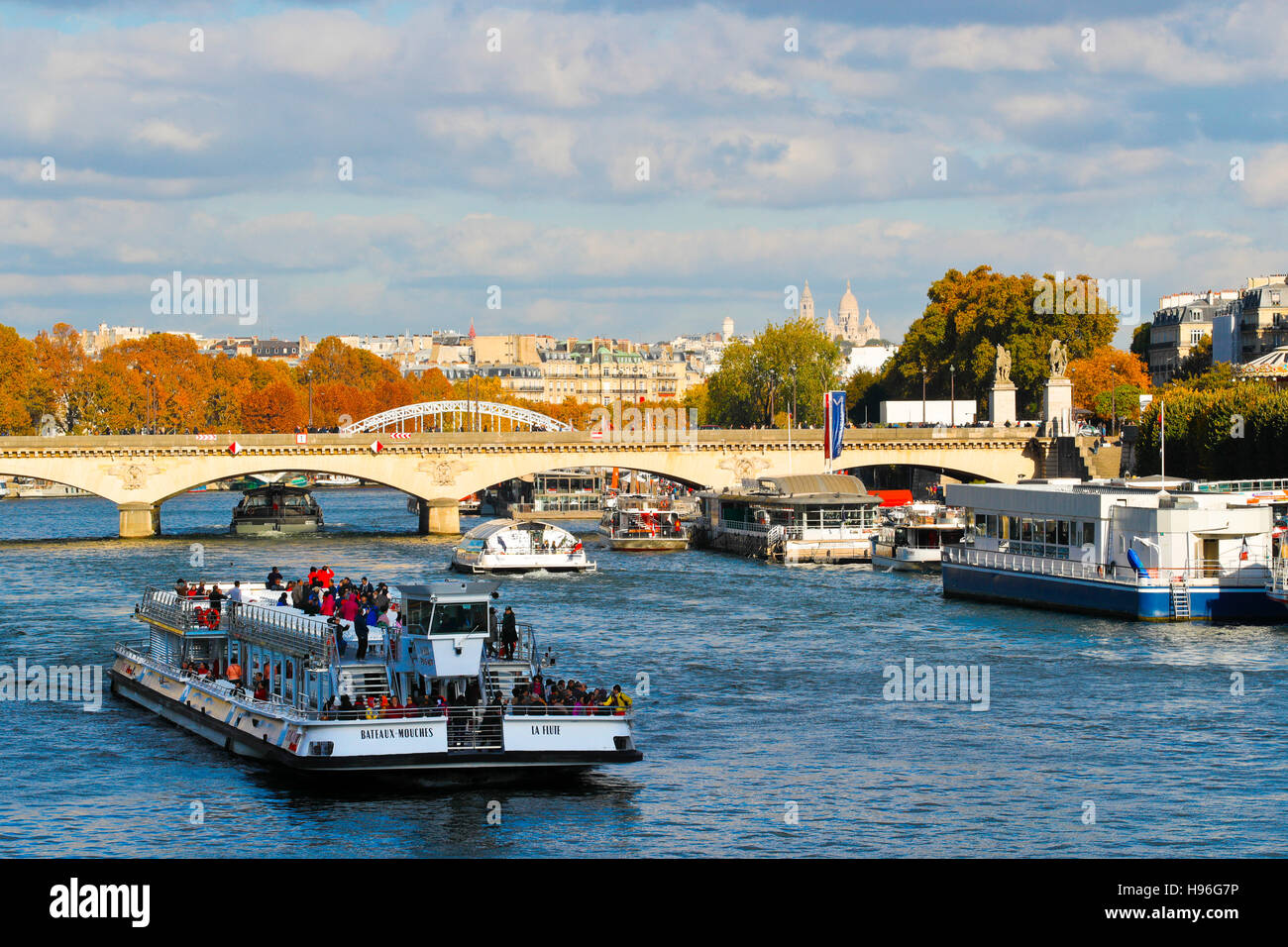 France. Paris. Tourists boats in the river Seine - Stock Image