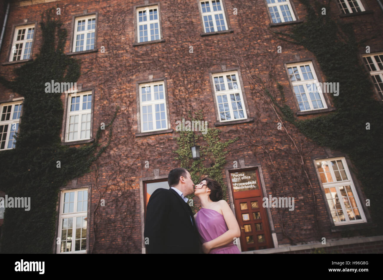 Young wedding couple in love story, bride and groom posing near ...