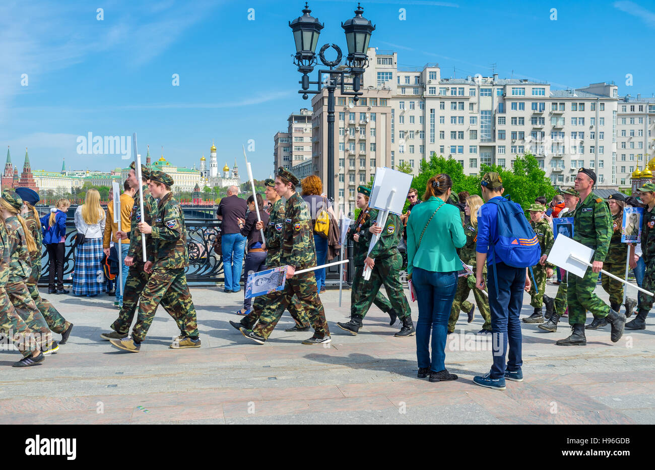 People of the immortal regiment carrying photographs of veterans who went through World War II - Stock Image