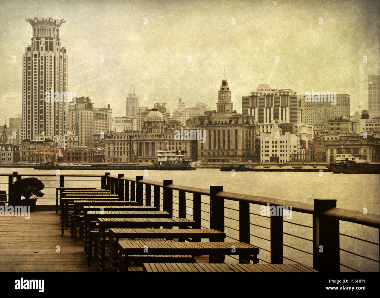 Shanghai's Bund from across the Pudong River aged with texture to provide a historic feel - Stock Image