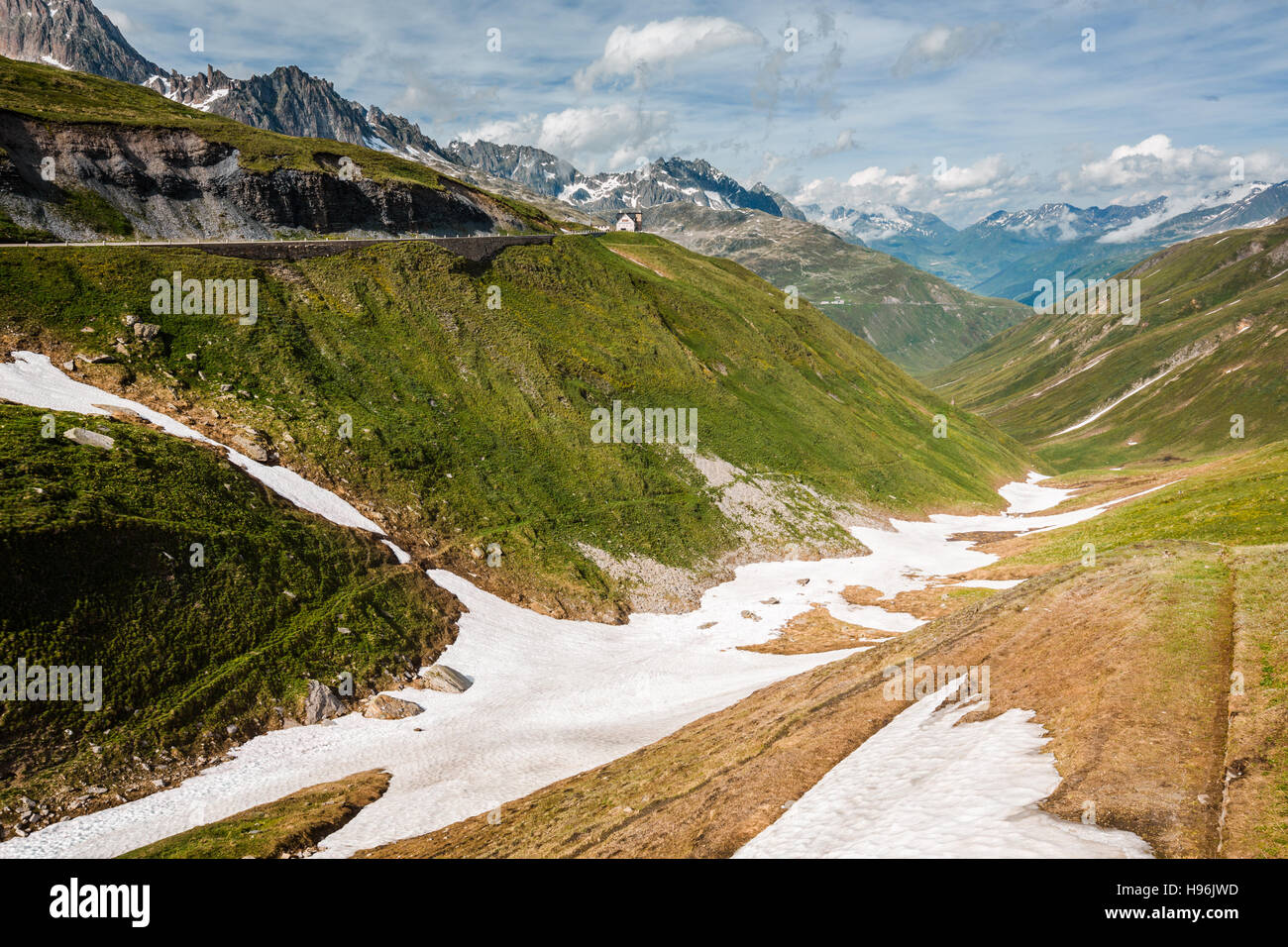 Valley near top of Furka pass, road on the left, Switzerland Stock Photo