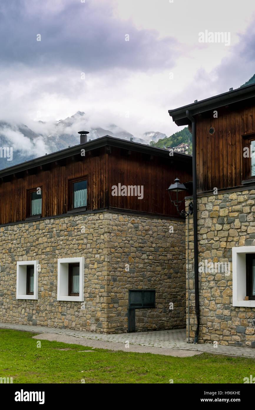 Mountain retreat in a cloudy scene - Stock Image