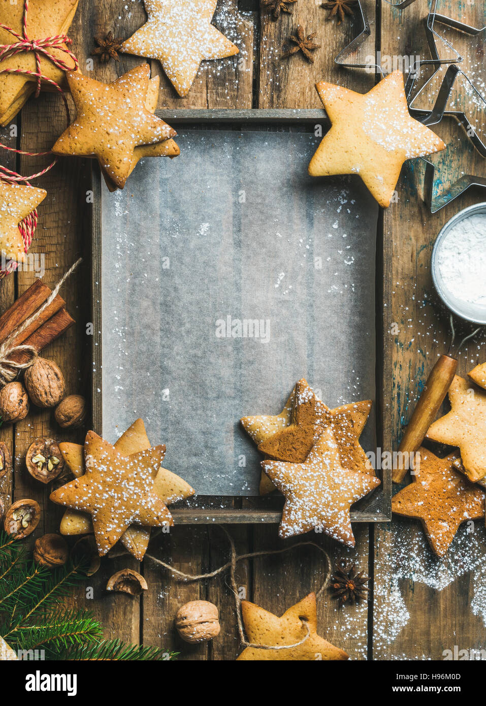New Year background, wooden tray with baking paper in center - Stock Image