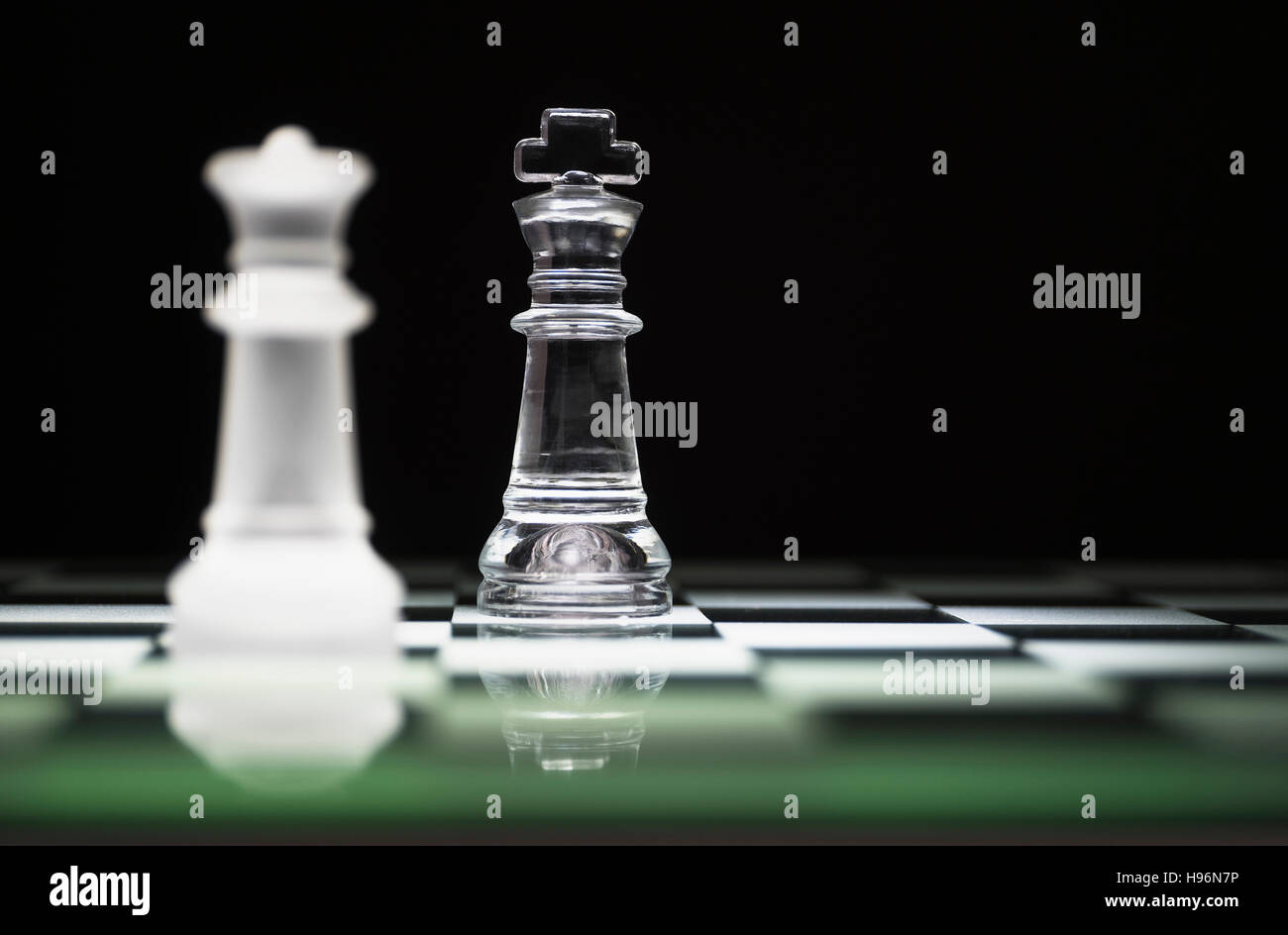 Chess queen and king on chess board - Stock Image