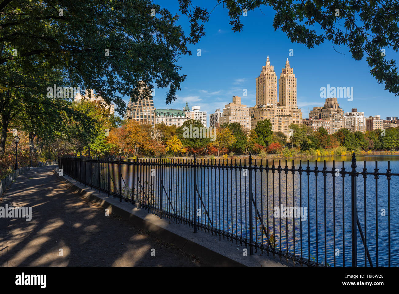 Upper West Side with colorful fall foliage across Jacqueline Kennedy Onassis Reservoir. Central Park West. New York - Stock Image