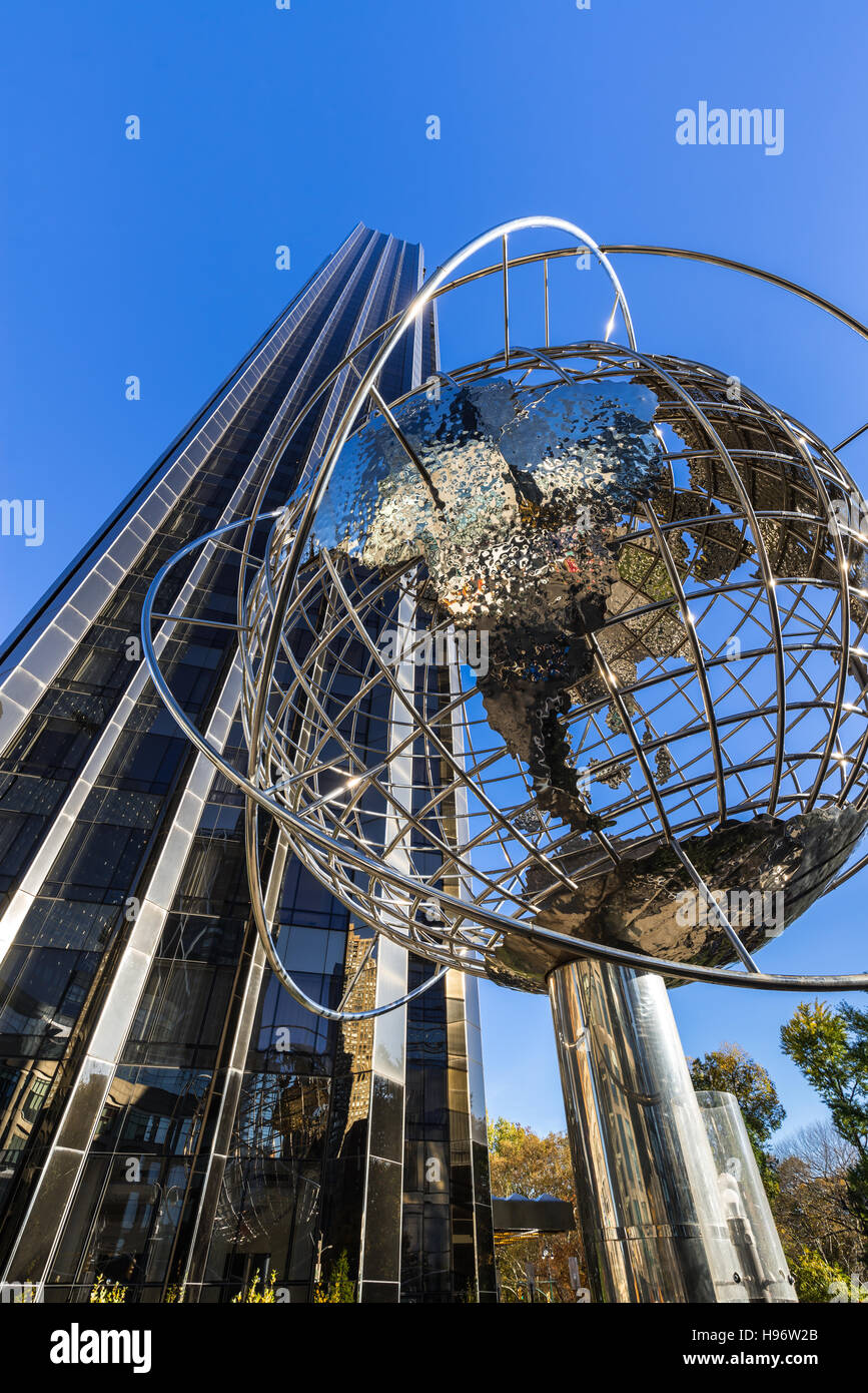 Trump International Hotel and Tower skyscraper with steel globe sculpture. Midtown, Manhattan, New York City - Stock Image