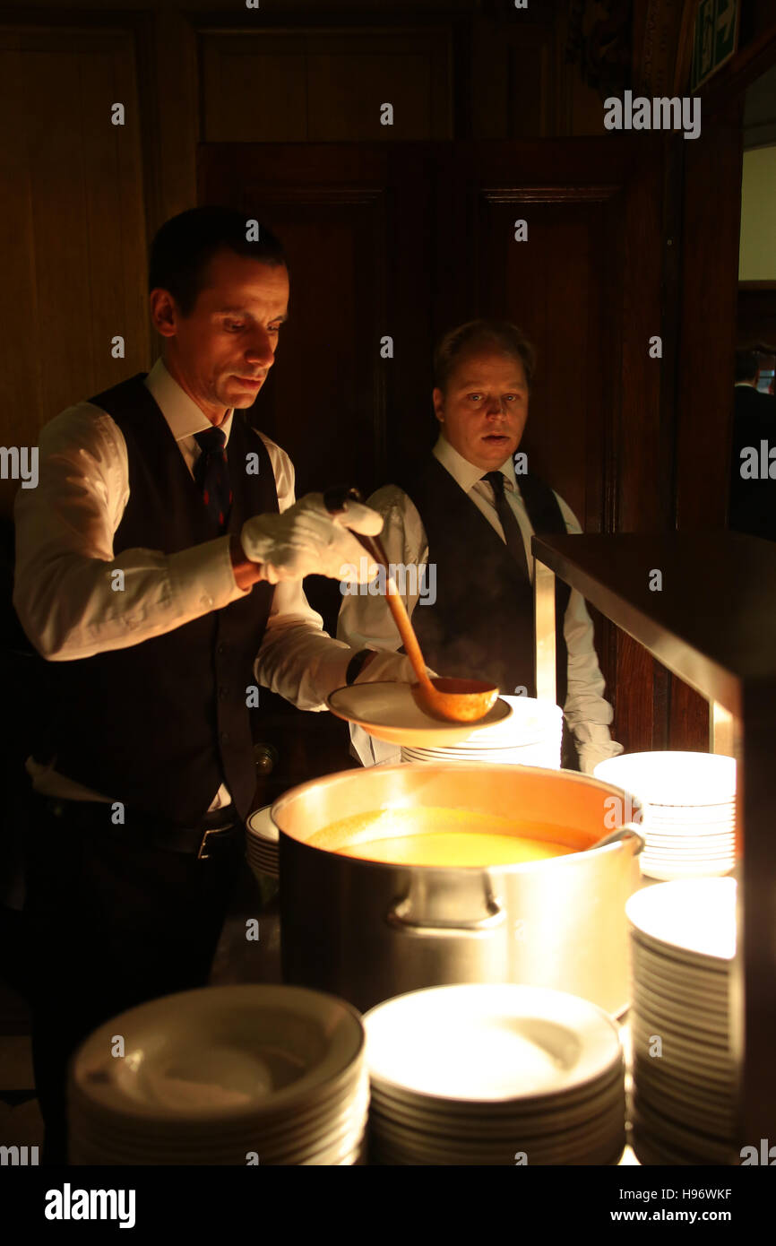 Waiters serving soup in Exeter College, Oxford. From a series of photos taken at the OxIMUN 2016. - Stock Image