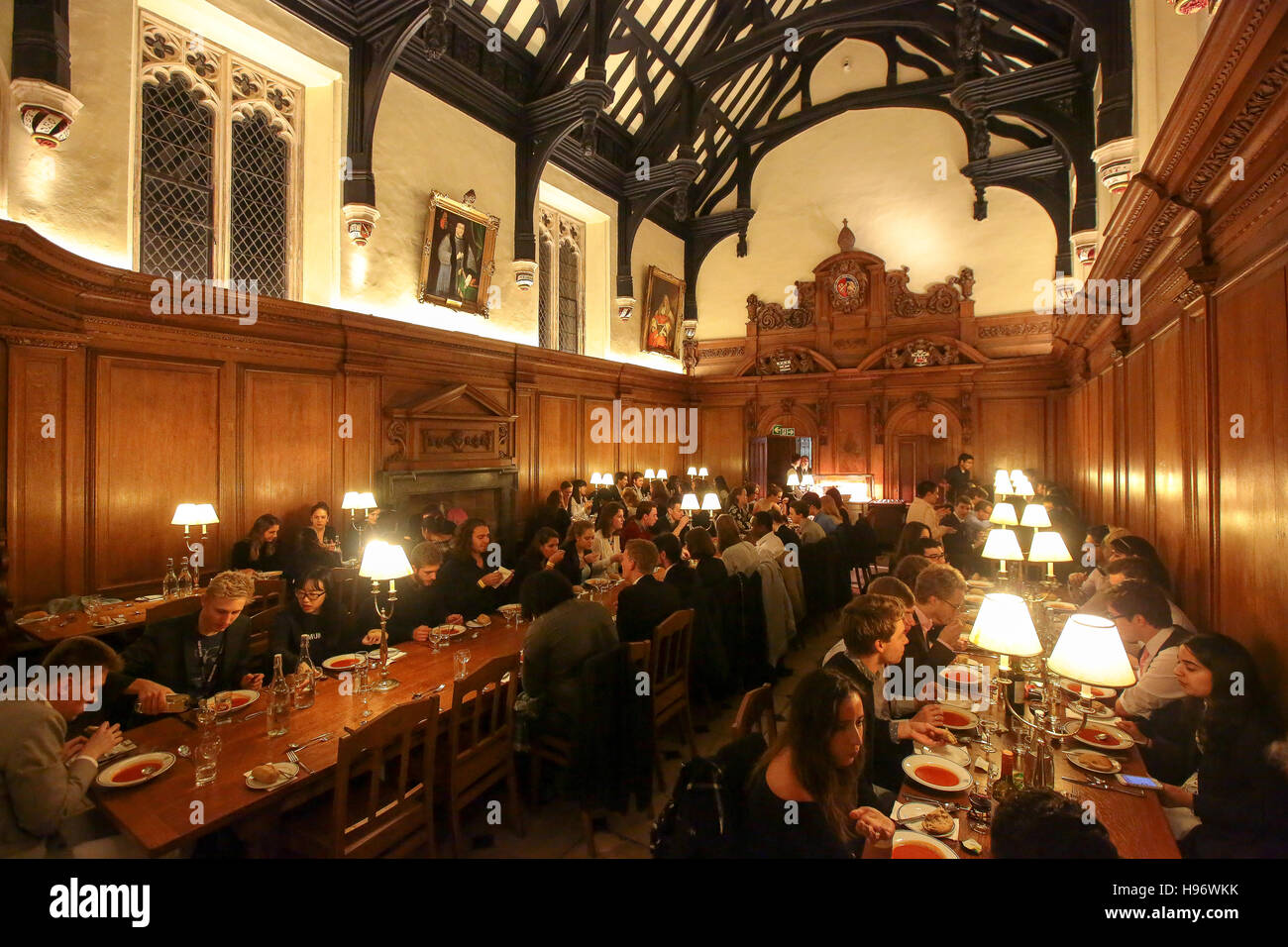 Students attending OxIMUN having dinner in the Corpus Christi College dining hall. From a series of photos taken - Stock Image