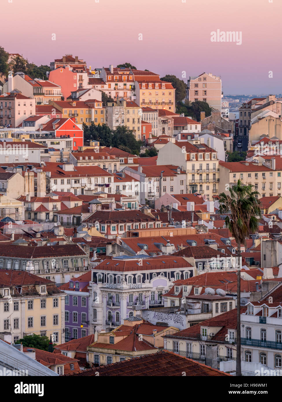 Cityscape of Lisbon, Portugal, seen from Miradouro Sao Pedro de Alcantara at sunset. - Stock Image