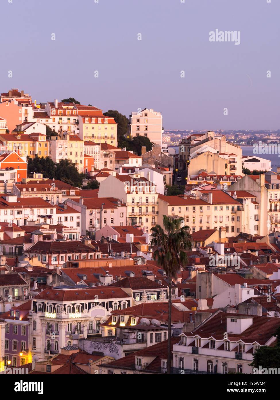 Cityscape of Lisbon, Portugal, seen from Miradouro Sao Pedro de Alcantara at sunset. - Stock Image