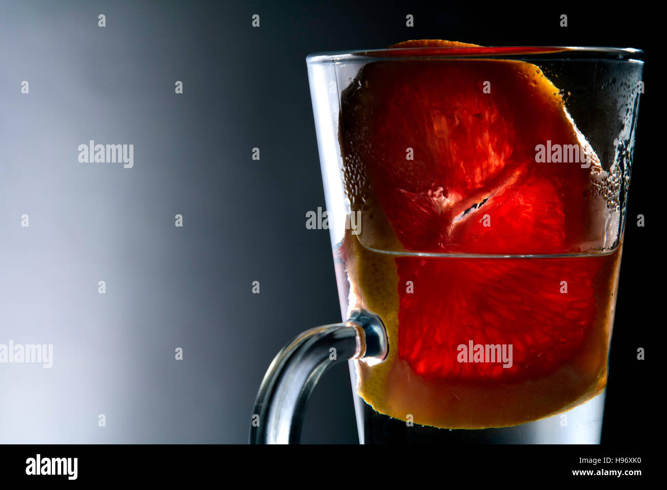 Abstract Still Life Of Thirst Quenching And Enticing Grape Fruit In Glass - Stock Image