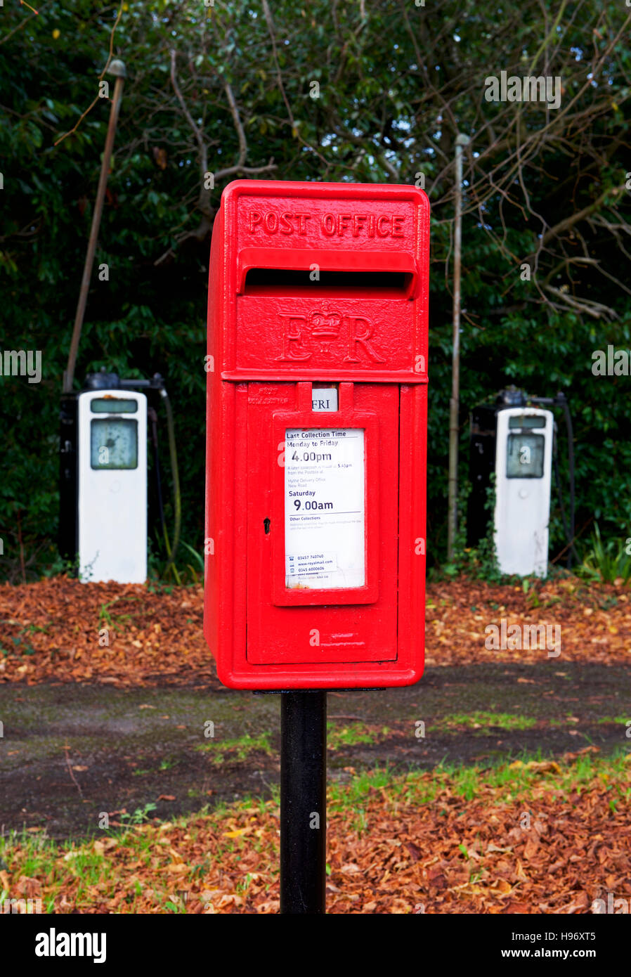 Postbox and gas pumps from abandoned petrol station, Exbury, New Forest, Hampshire, England UK, - Stock Image