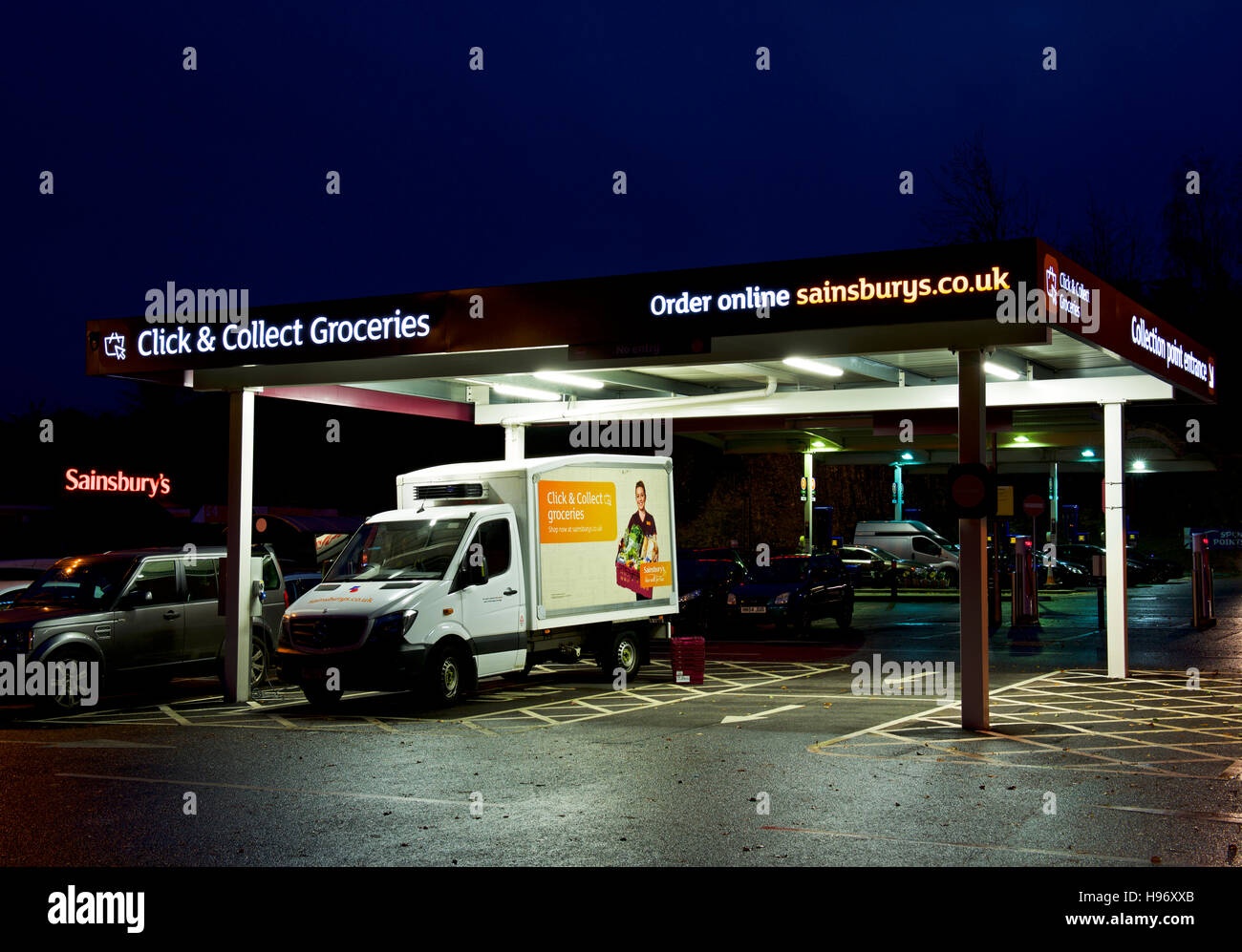 Delivery van parked in click & collection section of car park, Sainsbury's supermarket, England UK - Stock Image