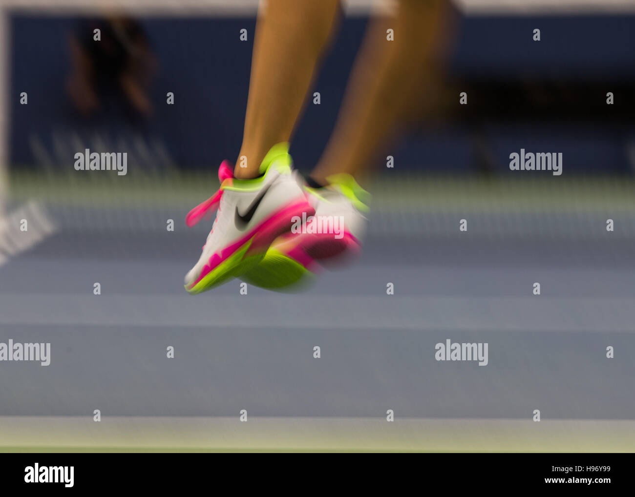 blurred feet of a professional tennis player at the US Open 2016 Stock Photo