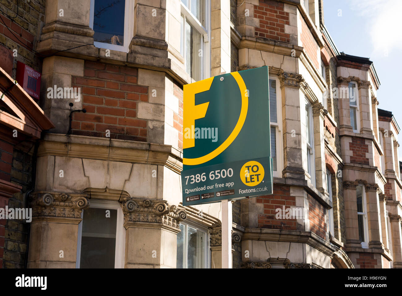 Foxtons Estate agent sign outside a row of Victorian terraced houses in London, England. - Stock Image
