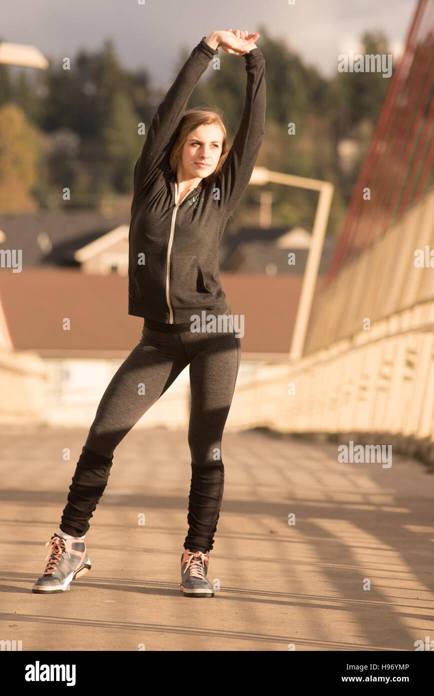 Beautiful woman in yoga pants - Stock Image