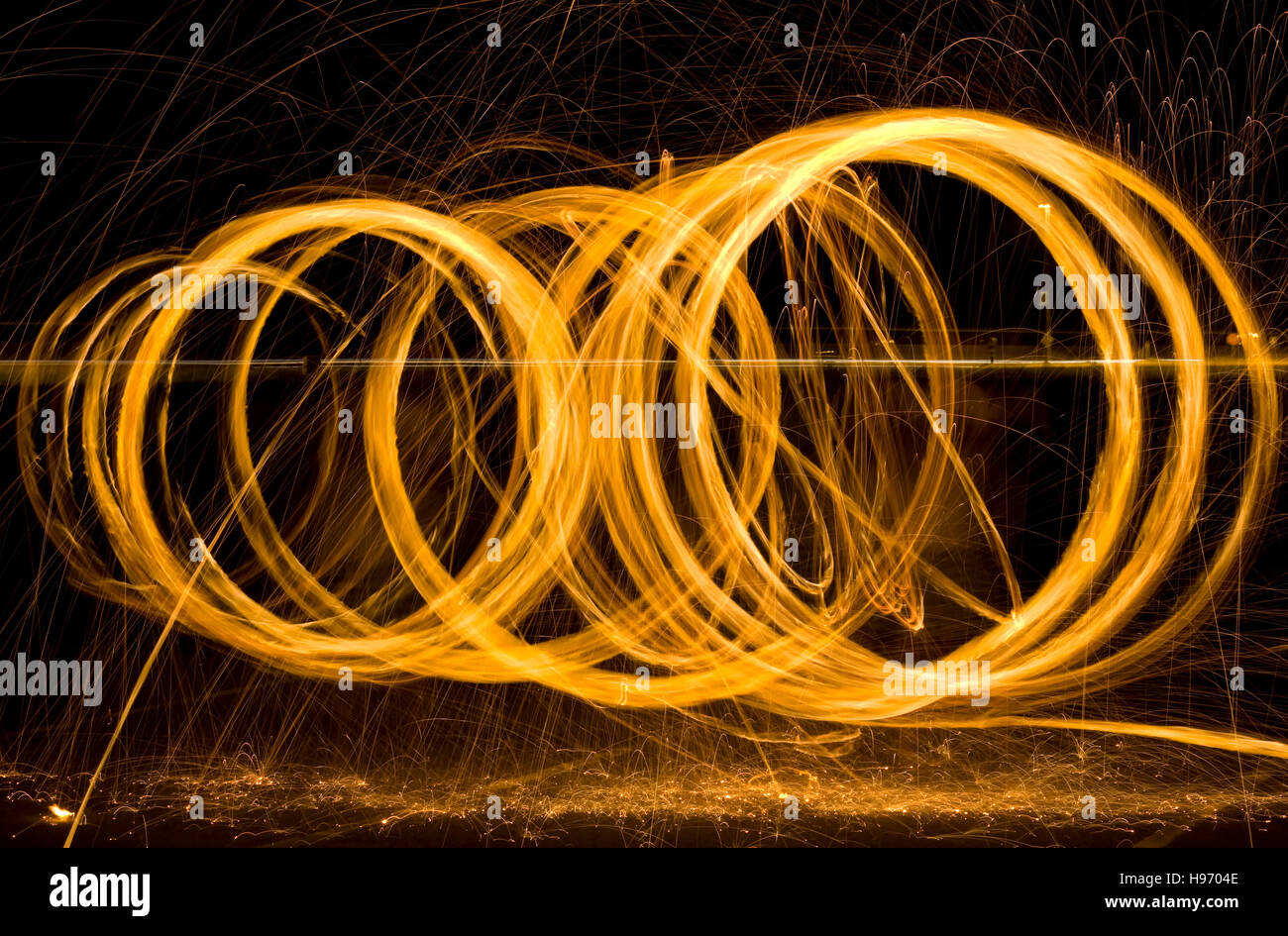 Round Light Painting Sparks at Night - Stock Image