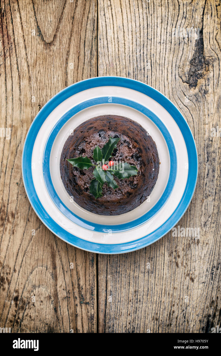 Christmas pudding on a plate from above - Stock Image
