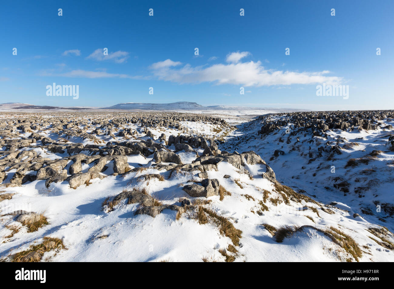 View down the Yorkshire Three Peaks footpath at Sulber Nick towards Pen-y-ghent, Yorkshire Dales, England, UK - Stock Image