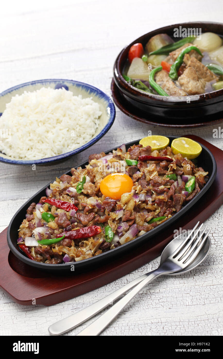 pork sisig and sinigang, filipino cuisine - Stock Image