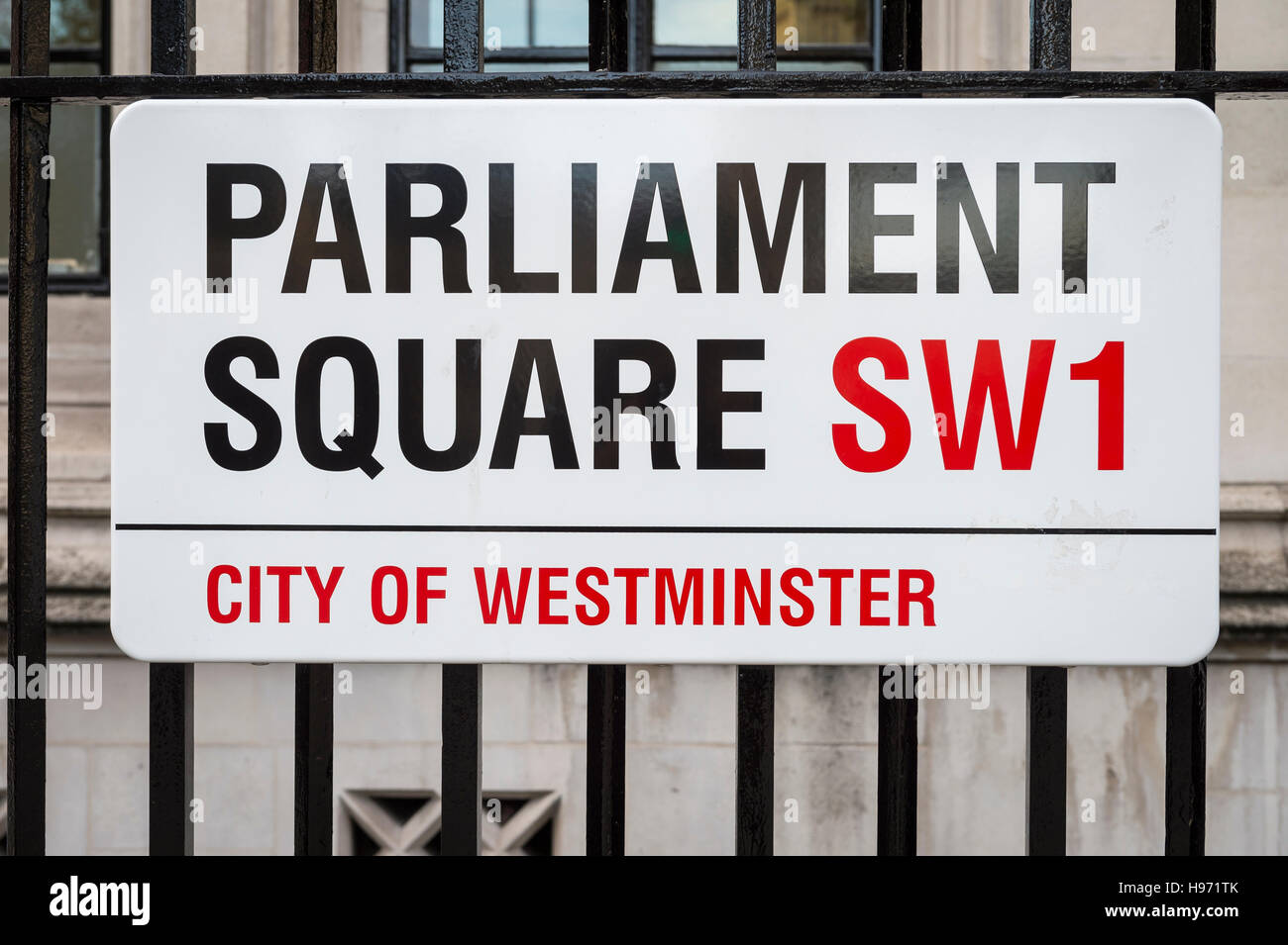 LONDON - NOVEMBER 16, 2016: Street sign for Parliament Square marks the open space between Westminster and the Supreme - Stock Image