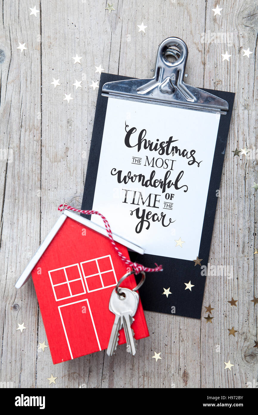Creative Christmas Background with a key and a new house - Stock Image