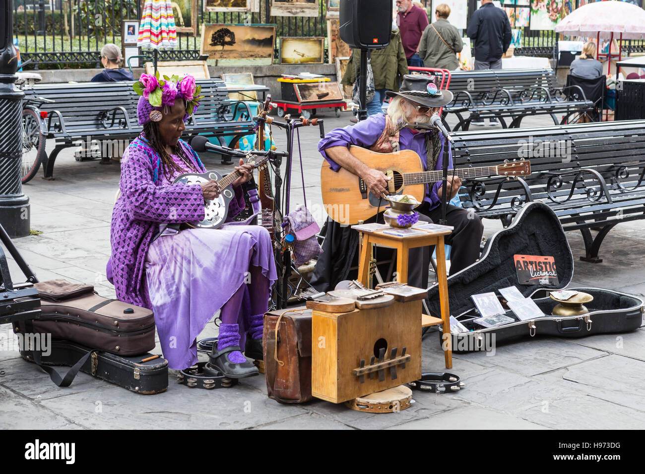 Street musicians play for passing tourists in Jackson Square in the French Quarter of New Orleans, Louisiana. - Stock Image