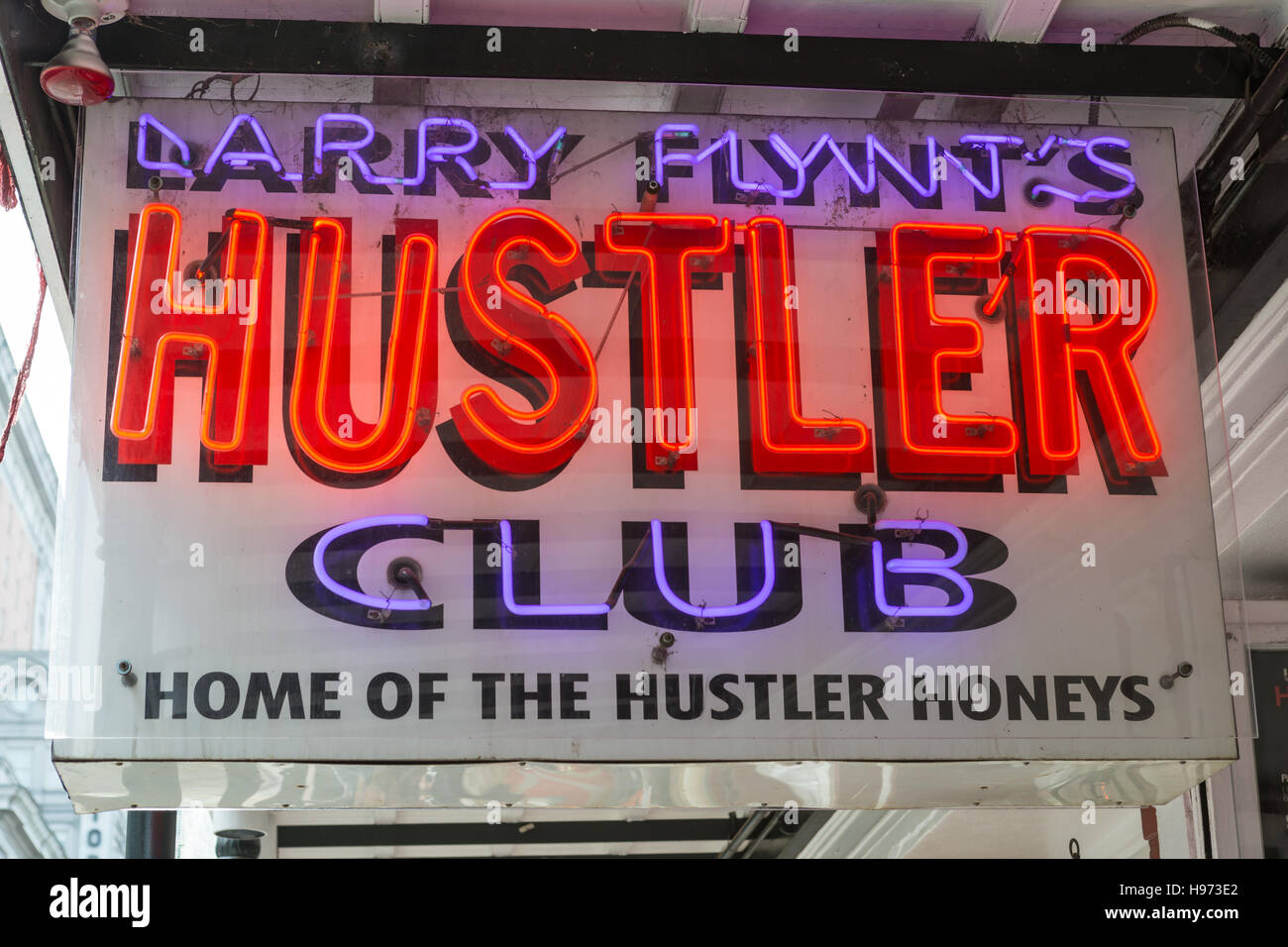 A neon sign outside Larry Flynt's Hustler Club on Bourbon Street in the French Quarter of New Orleans, Louisiana. - Stock Image
