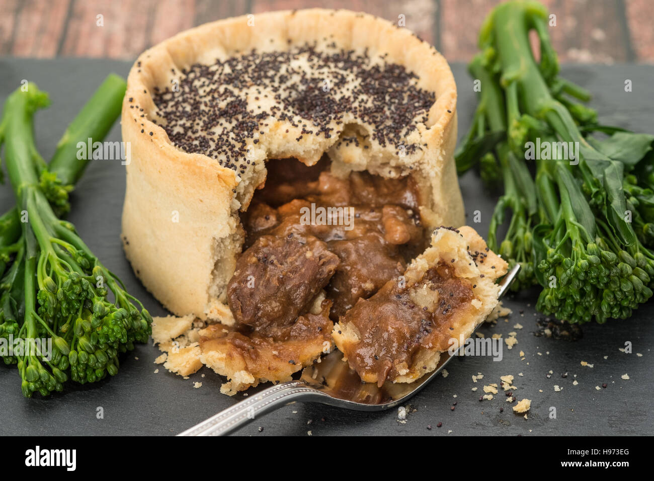 Steak and ale pie with broccoli - Stock Image
