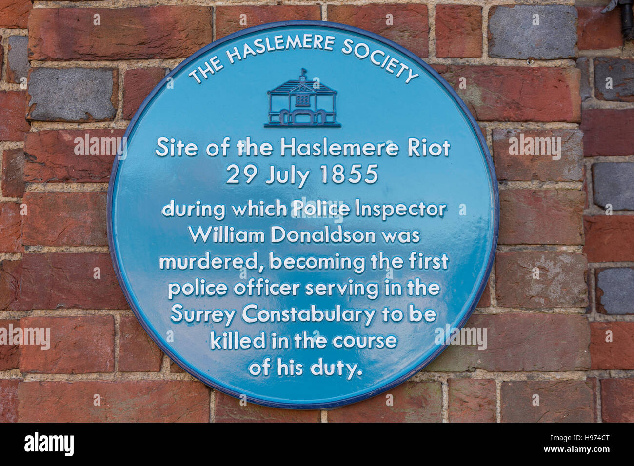 Blue plaque on site of the 1855 Haslemere Riot, High Street, Haslemere, Surrey, England, United Kingdom - Stock Image