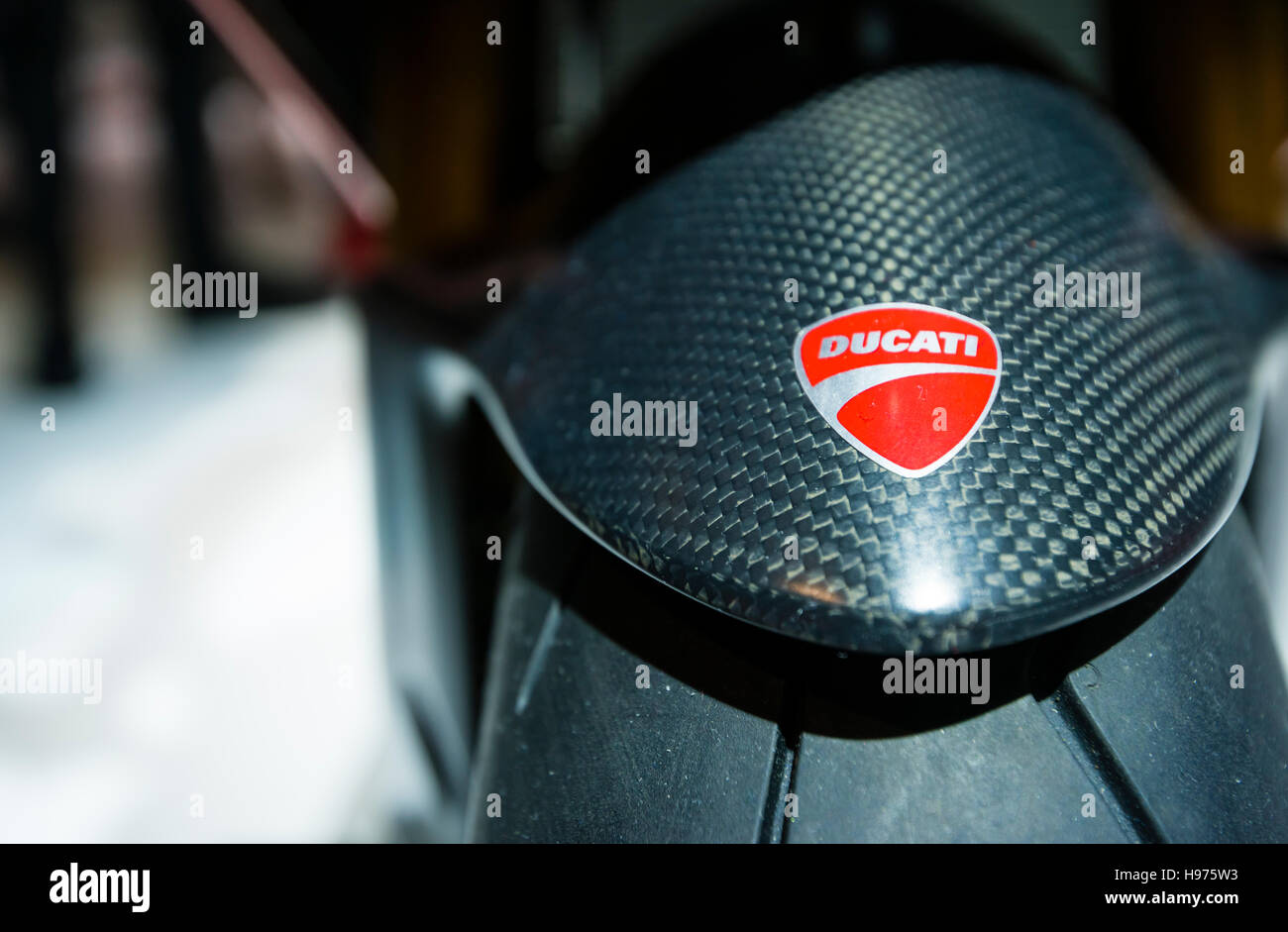 Zurich, Switzerland - 21 Feb 2016: The Ducati logo on a carbon fibre front fender of a Ducati racing motorbike, - Stock Image