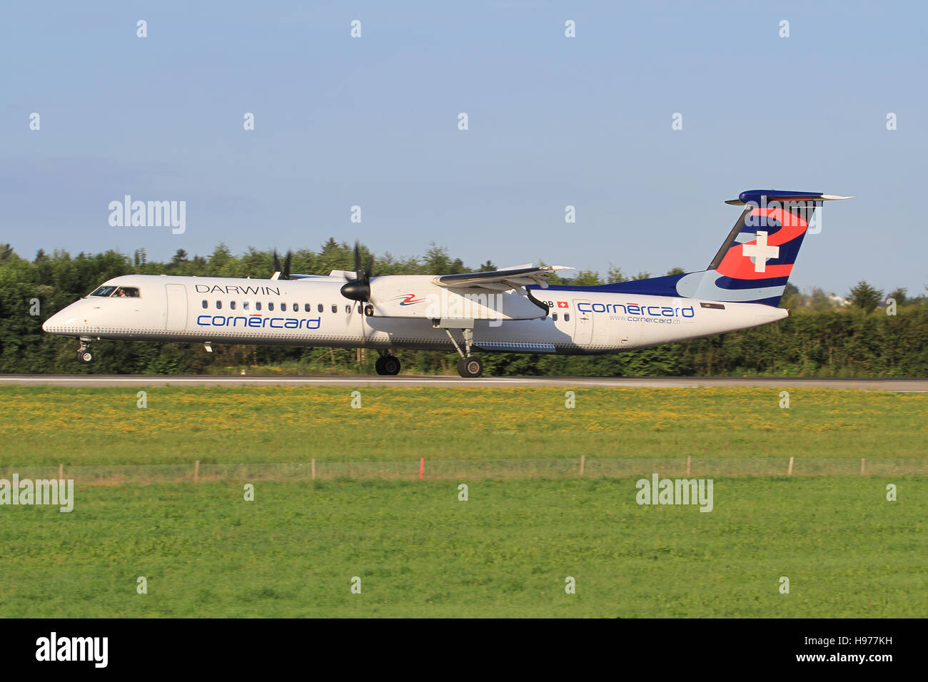 Zurich/Switzerland July10, 2016: Dash 8 from Darwin landing at Zurich Airport. - Stock Image