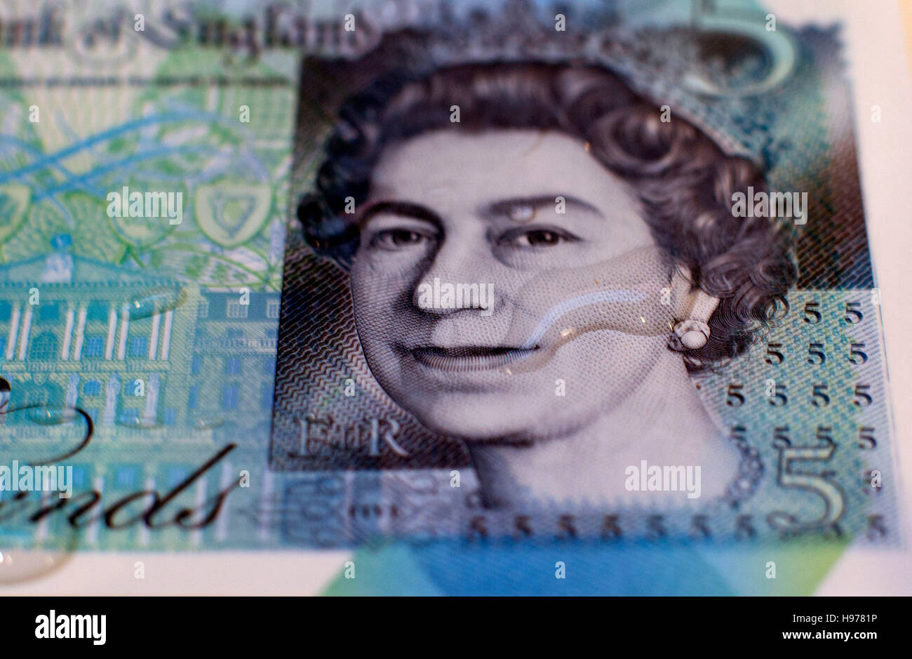 New polymer fiver pound note with water drop, London - Stock Image