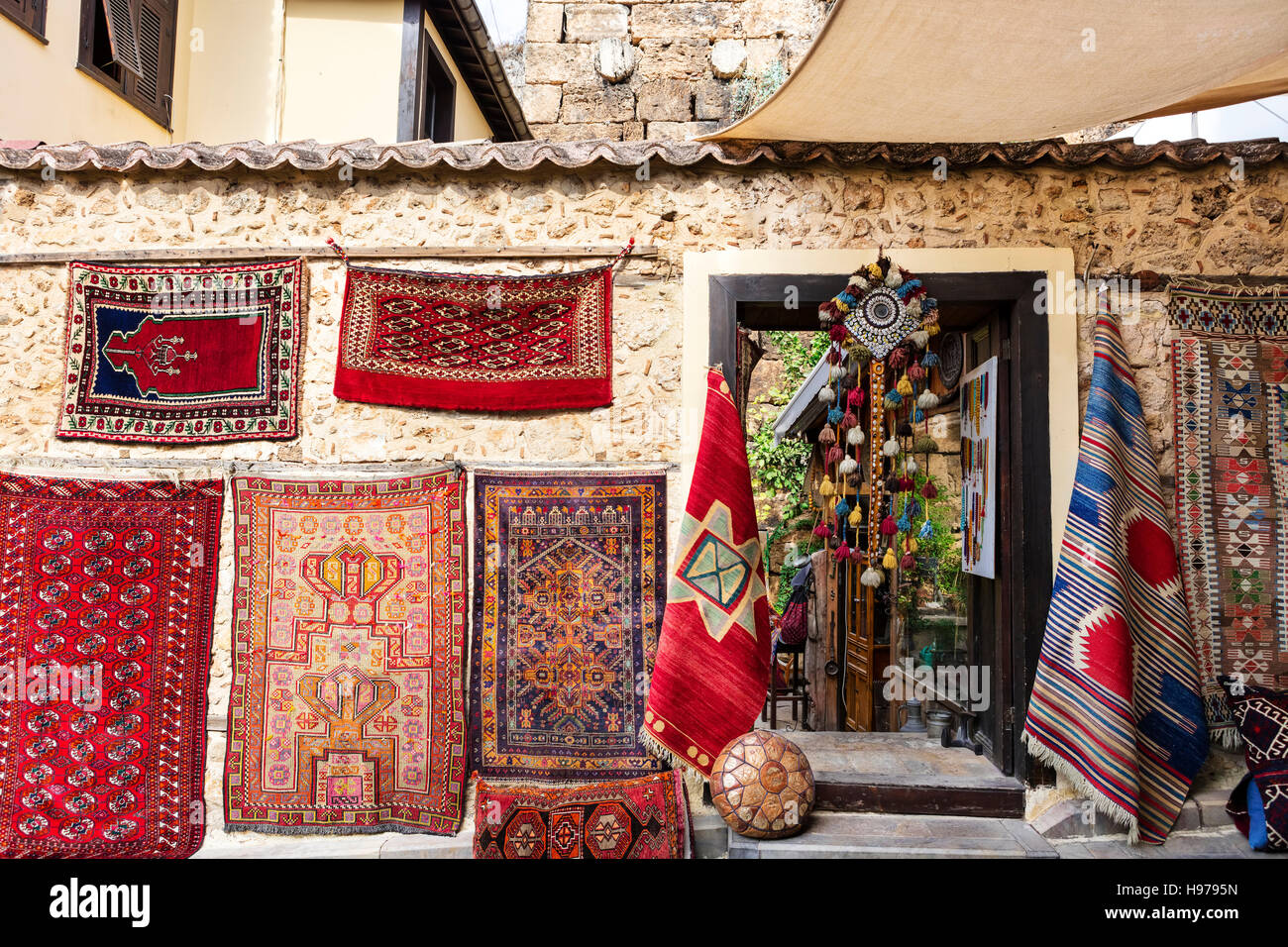 Eastern town street shopping for carpets and antiques. - Stock Image