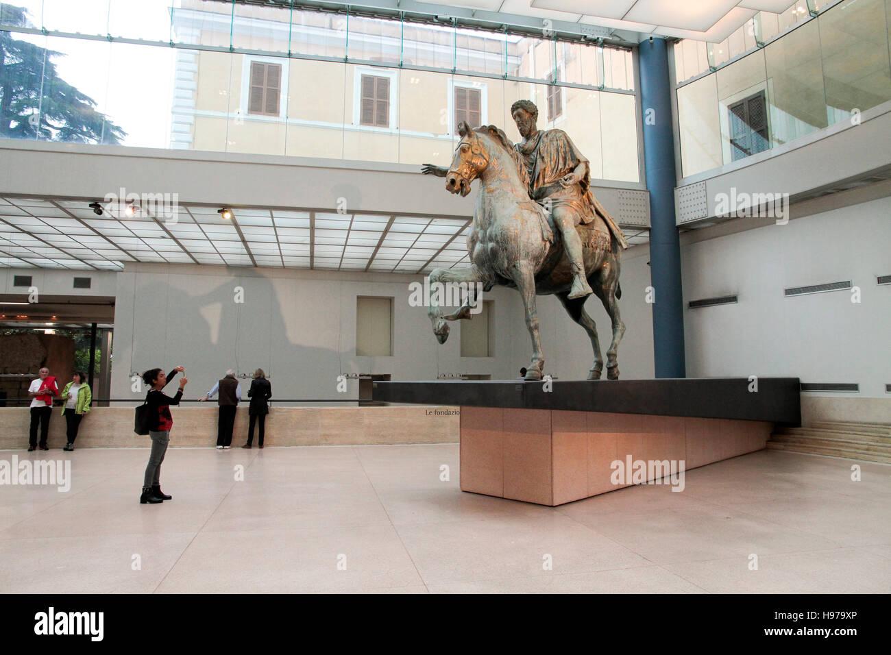Tourists looking Emperor Marco Aurelio on horseback italy, capitoline museums,  musei capitolini art heritage touristic - Stock Image