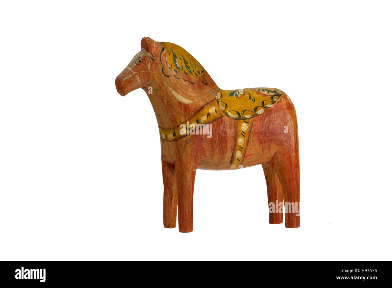 This old and charming Dala Horse (Dalecarlian Horse) has nearly the same form as the modern ones, isolated on a - Stock Image