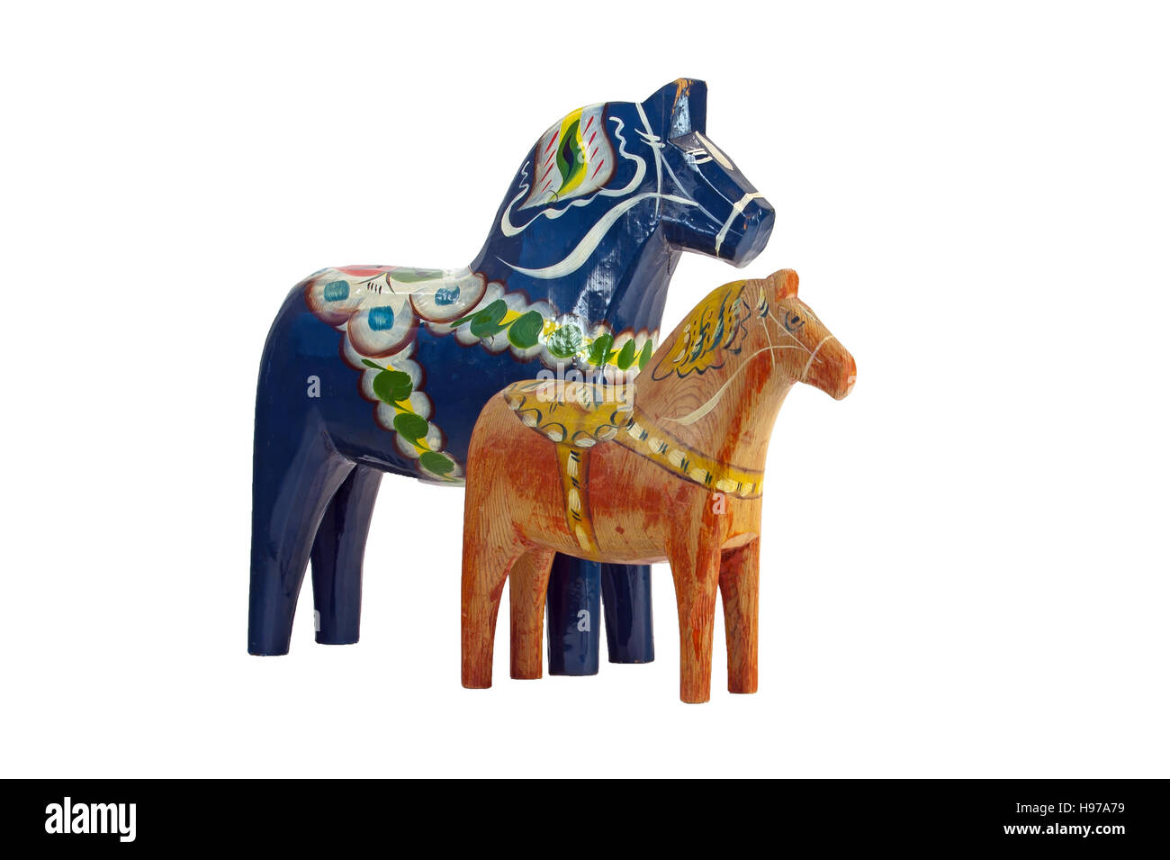 A more modern and blue Dala (Dalecarlian) Horse together with an old red worn Dala Horse, isolated on a white background. - Stock Image
