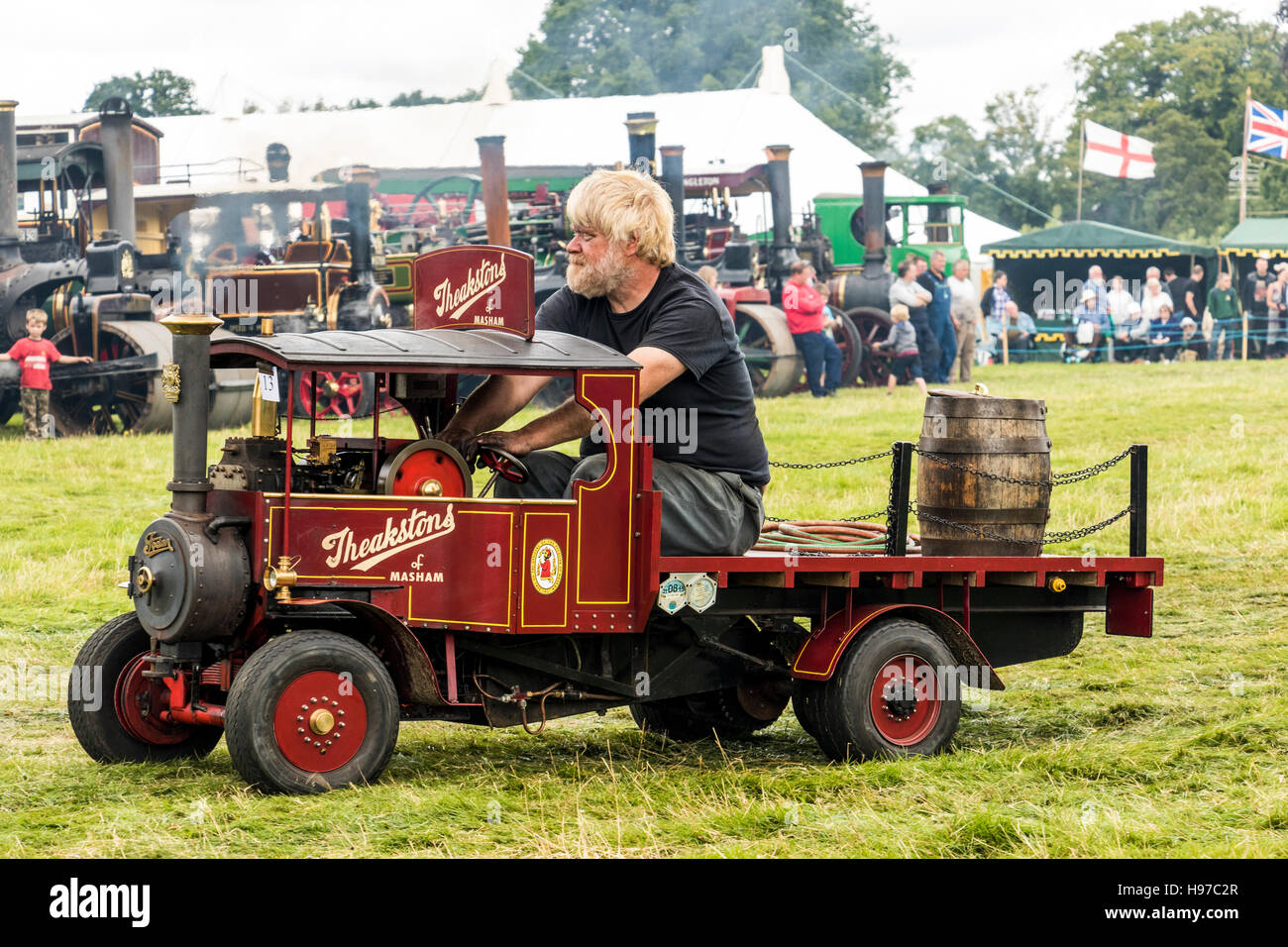 Miniature steam truck being driven and displayed at Astle Park Traction Engine Rally 2016 at Chelford Cheshire England - Stock Image