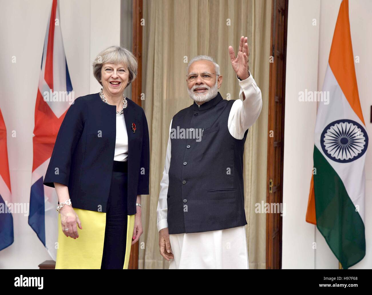 Indian Prime Minister Narendra Modi with British Prime Minister Theresa May before their bilateral meeting at Hyderabad Stock Photo