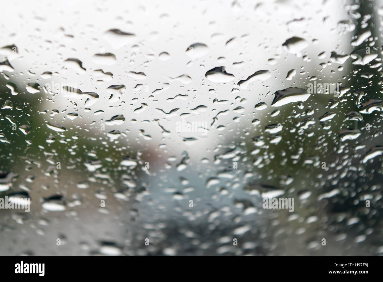 Raindrop on a glass useful as a background - Stock Image