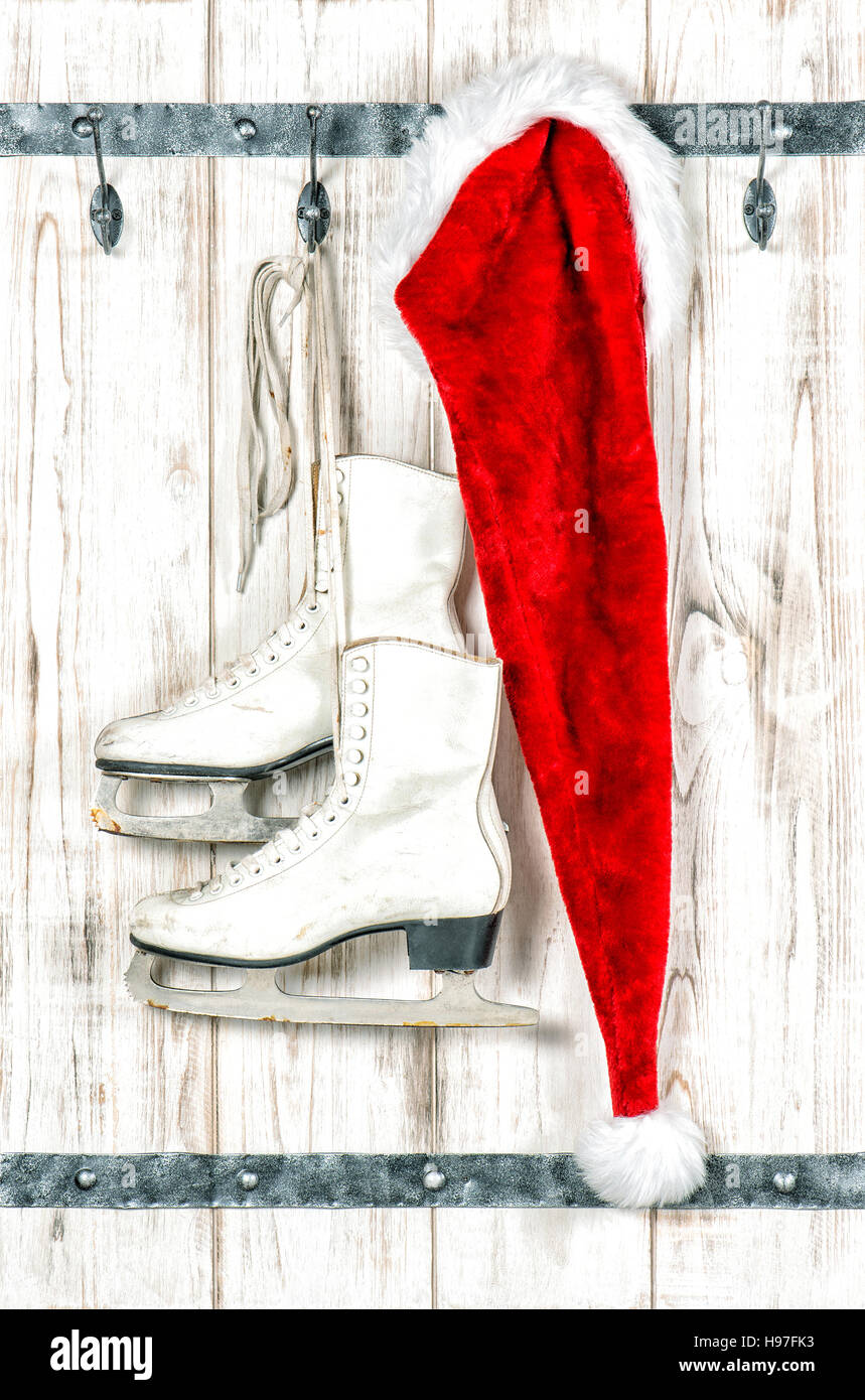 Christmas decoration. Red Santas hat and vintage ice skates on ...