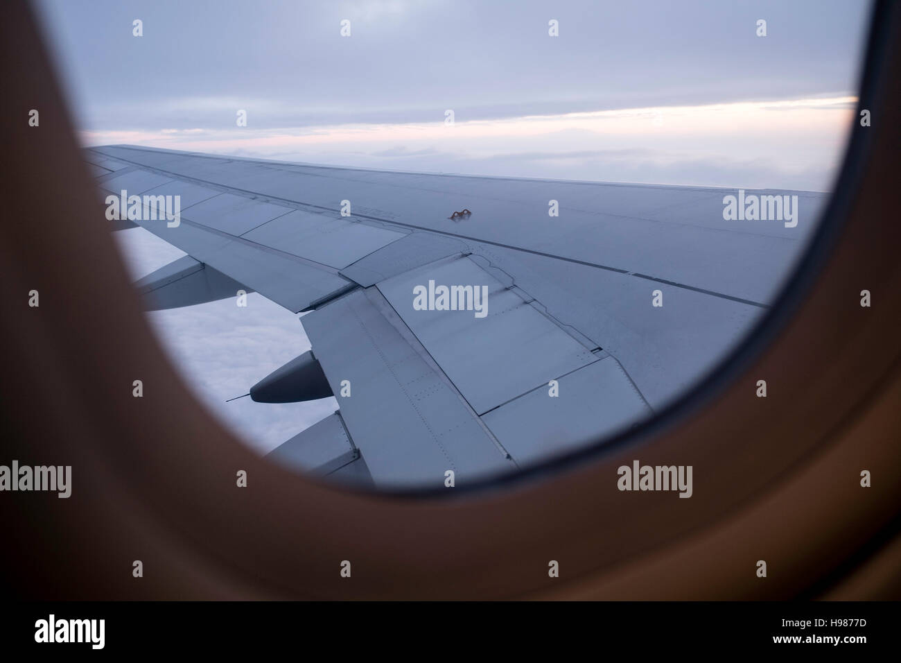 view airplane window clouds dramatic seat travel - Stock Image