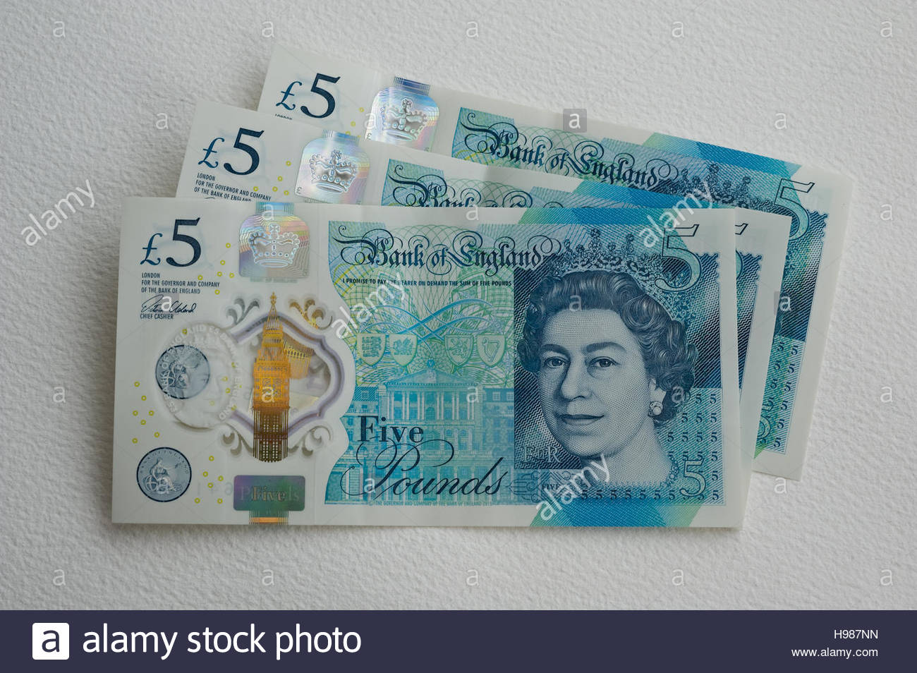 Three New Five pound notes - Stock Image