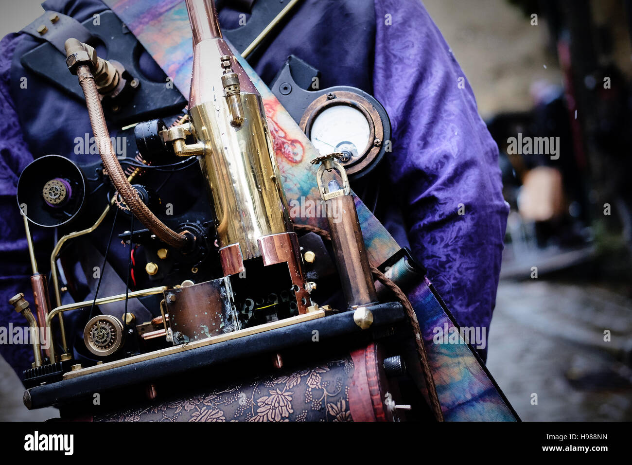 A backpack of steam powered apparatus worn by a steampunk enthusiast at an event - Stock Image