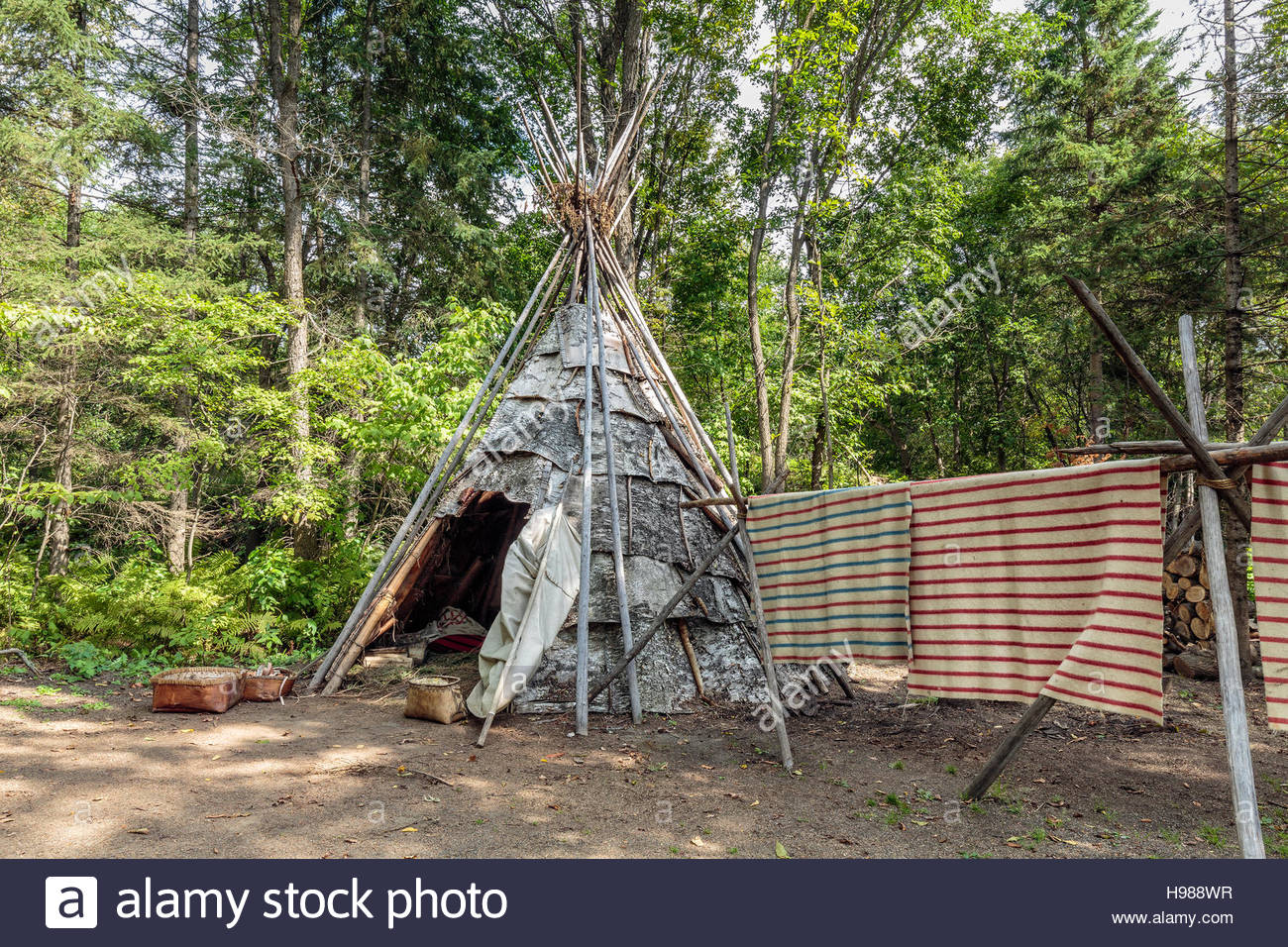 Native encampment of the Ojibwa or Cree people, Fort William National Historic Site, Thunder Bay, Ontario, Canada. - Stock Image