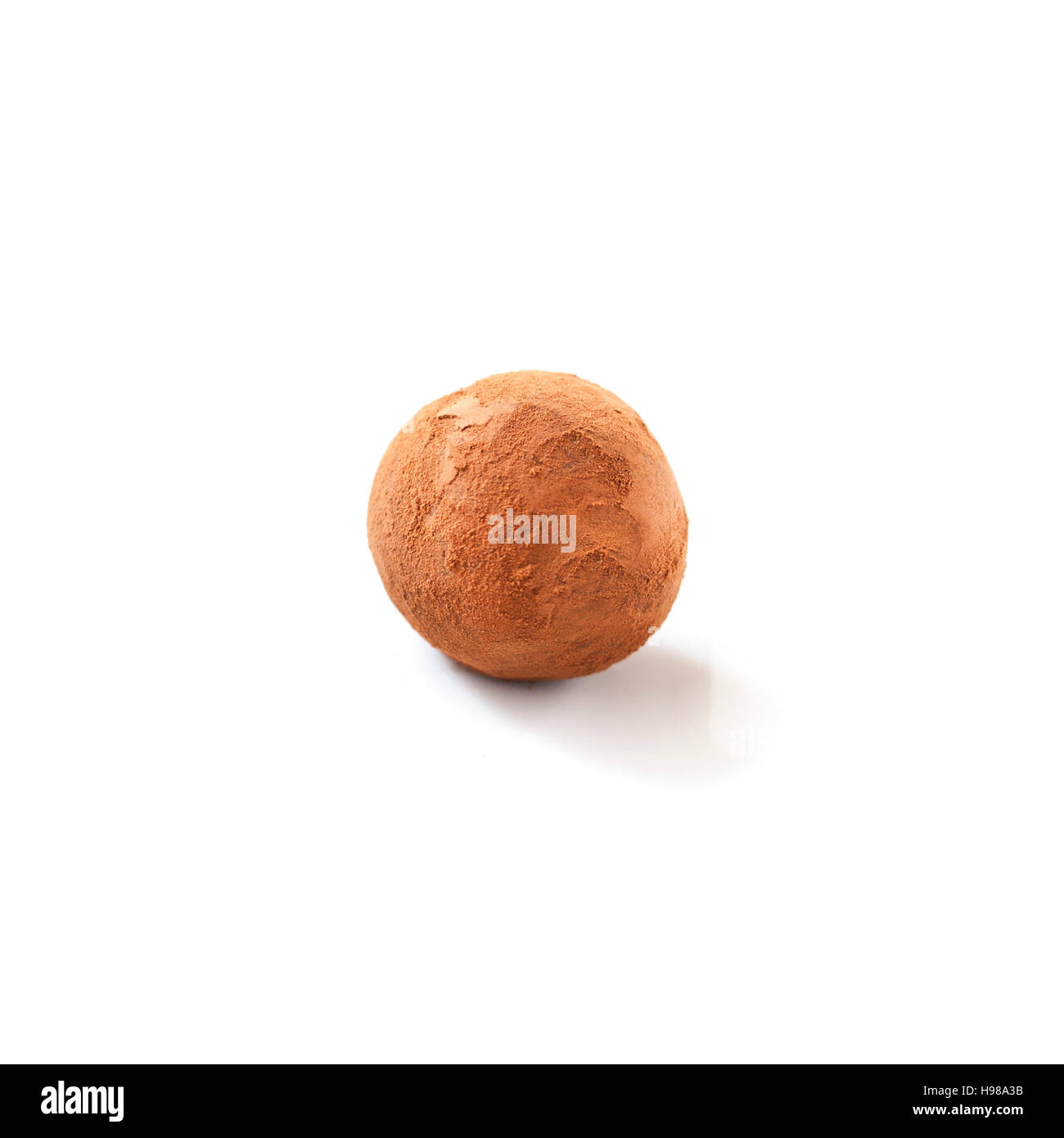 Single Chocolate Truffle dusted in cocoa powder, on White Background - Stock Image