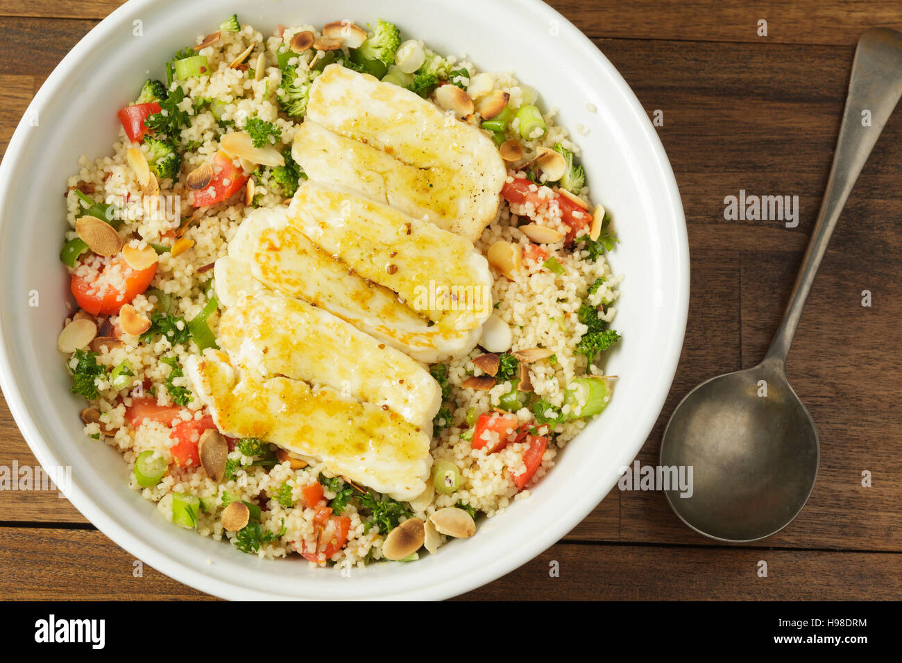 couscous salad with halloumi - Stock Image